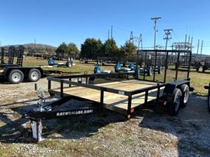 Utility Trailer Tandem By Gator 14ft  Utility Trailer Tandem By Gator 14ft. Dual Axle trailer with treated wood floor, powder coat finish, and spring assisted tailgate.